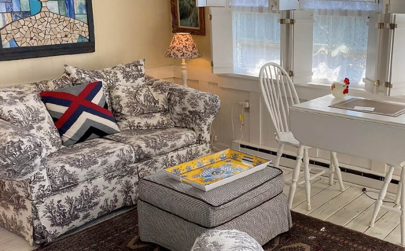 BowSprit guest suite with couch and table