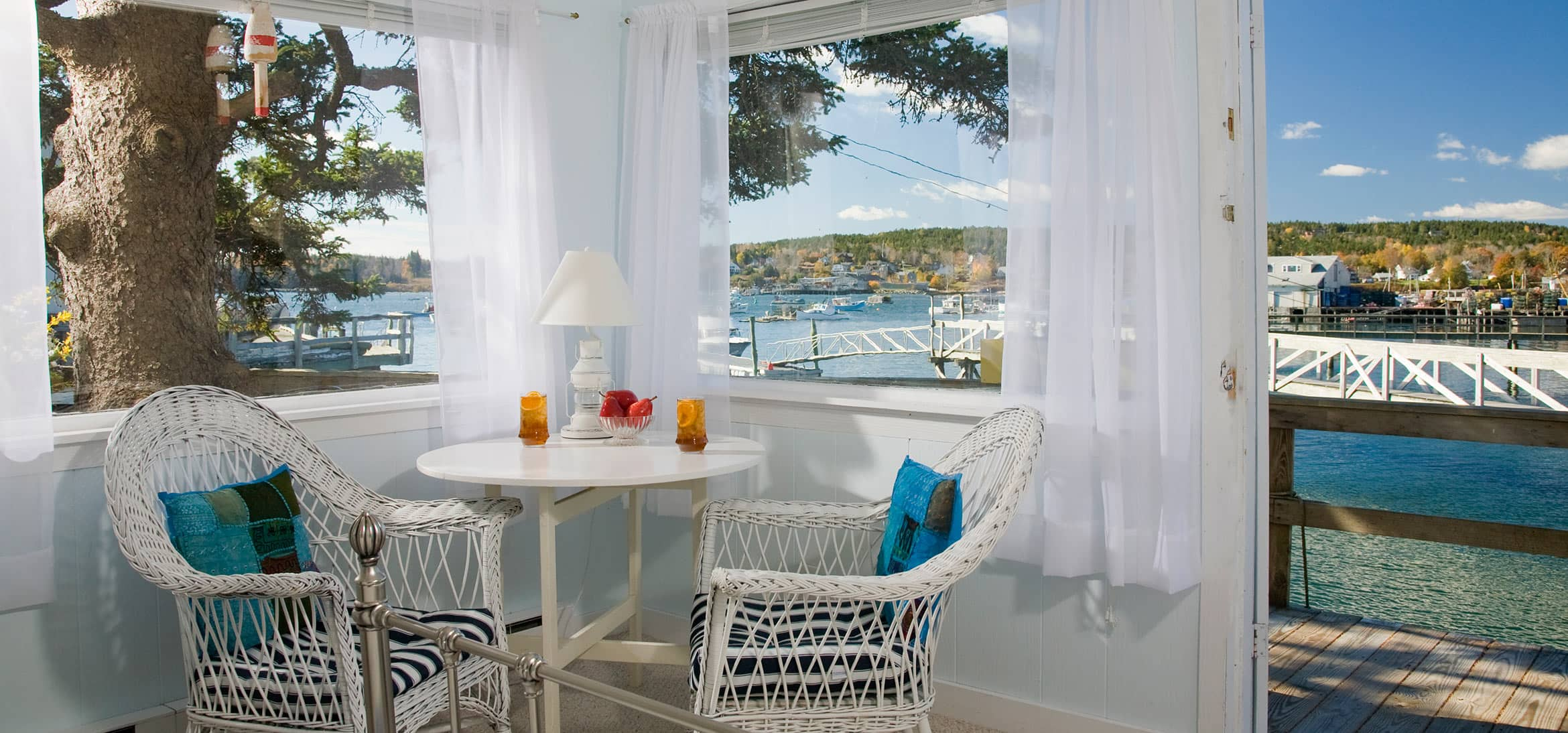 Table with wicker chairs and stunning view in Deck House
