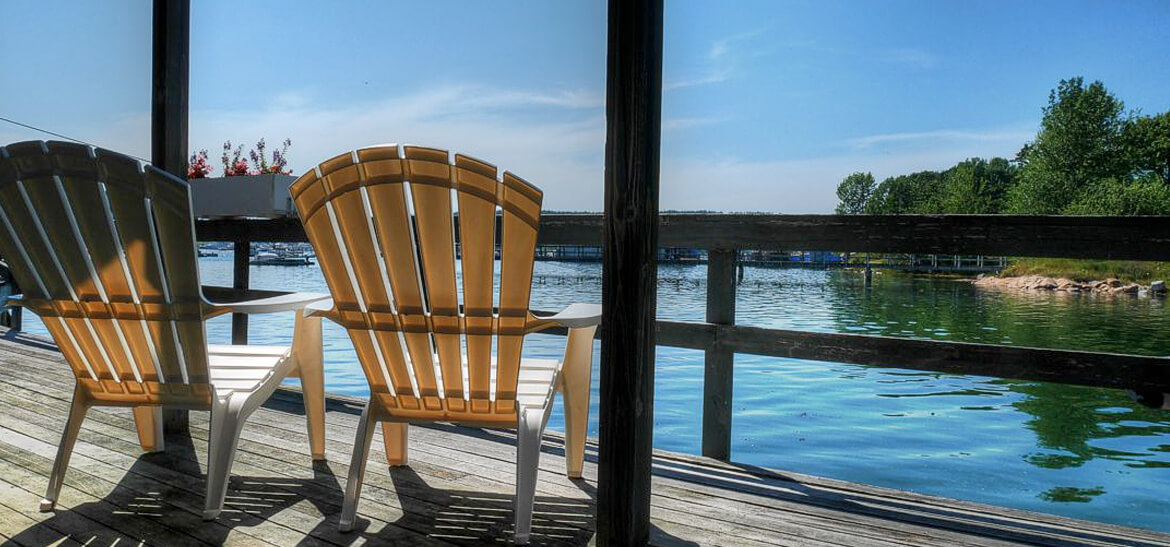 two chairs on waterfront deck