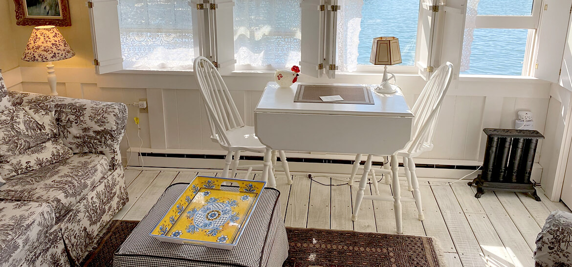 white table and white floors in vintage Maine cabin