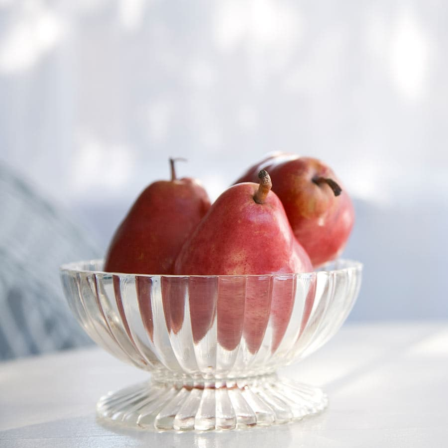 Red pears in a glass bowl