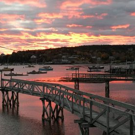 colorful sunset over Maine harbor